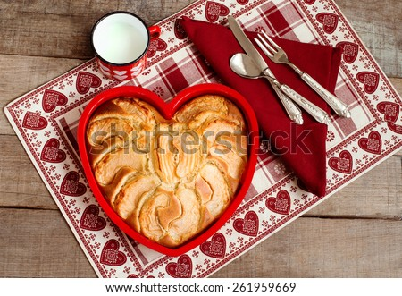 breakfast apple pie with milk mug over heart decorated country placemat - stock photo