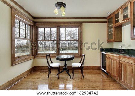 Breakfast area with sink and wood cabinetry - stock photo