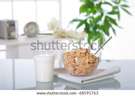 breakfast at home  breakfast at home  with cereal and  milk  over glass table - stock photo