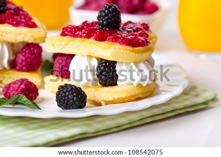 Breakfast, Belgian waffles  with berries and whipped cream