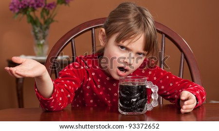 Breakfast Beverage Confusion - 5 y/o child reacts to being served black coffee - stock photo