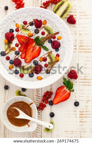 Breakfast bowl: coconut chia pudding with fruits, berries and nut butter. - stock photo