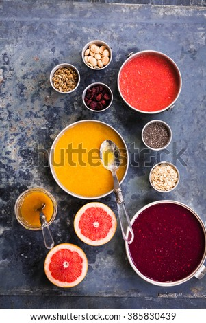 Breakfast bowl colorful collage. Superfoods and purple acai smoothie and yogurt recipe collection. Berry pomegranate beet smoothie bowl with various foods seeds and cereals. - stock photo