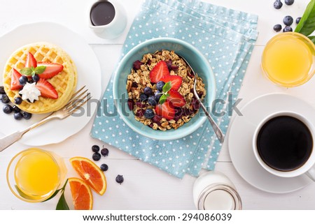 Breakfast bowl with homemade granola and berries - stock photo