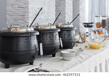 Breakfast buffet with dishes and steam tables