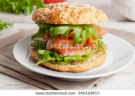 breakfast - burger with smoked salmon, vegetables, horizontal, close up - stock photo