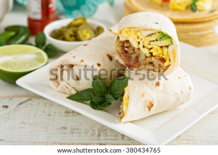 Breakfast burritos with eggs, bacon and potatoes - stock photo