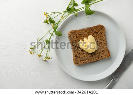 Breakfast butter and toast - stock photo