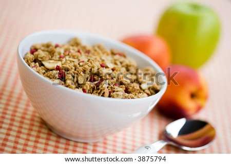 Breakfast cereal with dried fruits and fresh peaches - stock photo