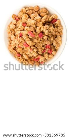 Breakfast cereal with dried raspberry fruit pieces in white bowl over white background