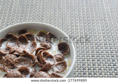 Breakfast Chocolate Cornflakes Cereal Bowl. - stock photo
