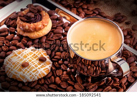 breakfast coffee cup with chocolate cookies. Vintage background