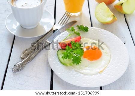 Breakfast: coffee, fried egg and apple - stock photo