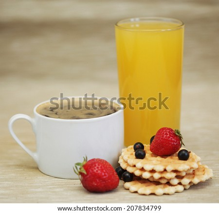 breakfast - coffee, orange juice and wafer. - stock photo