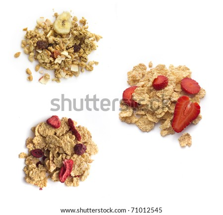 Breakfast collection : muesli and flakes with fruites isolated on white. Top view - stock photo