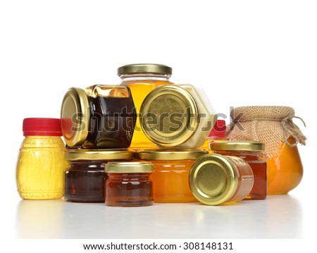 Breakfast concept sweet Tasty jars of jam and honey cream in row composition with blank text space isolated on white background - stock photo