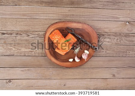 breakfast delicious portion fresh roast salmon fillet with dry spices garlic and rosemary wooden plate with black forged handmade fork healthy food diet cooking concept background empty space for text - stock photo