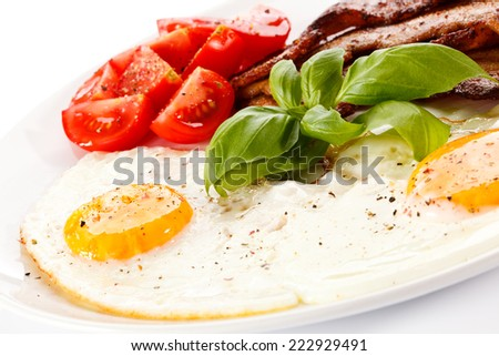 Breakfast - egg, bacon and vegetables - stock photo