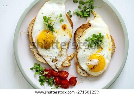 Breakfast, eggs on toast - stock photo
