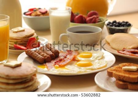 stock photo breakfast foods 53602882 Orange Coffee Table Heart Shaped Fried Eggs Bread And Orange Juice Stock Photo Image