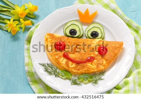 Breakfast for kids - frog princees omelette with vegetables - stock photo