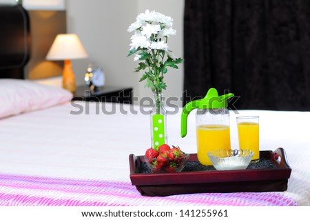 Breakfast in bed at a hotel room - stock photo