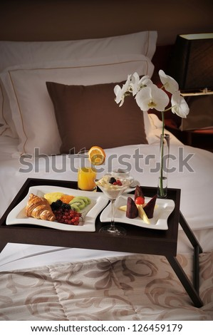 Breakfast in bed at a luxury hotel room - stock photo