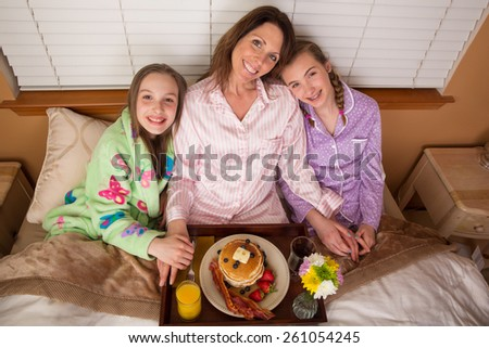 Breakfast in bed served for Mom on Mother's Day - stock photo