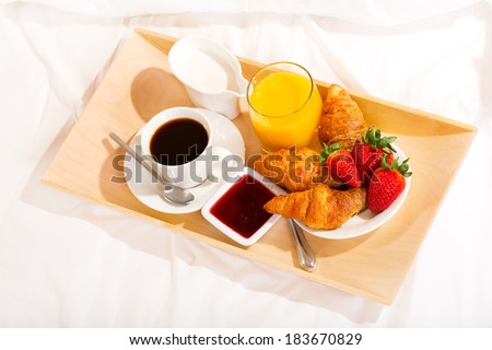 breakfast in bed with coffee, croissants and juice - stock photo