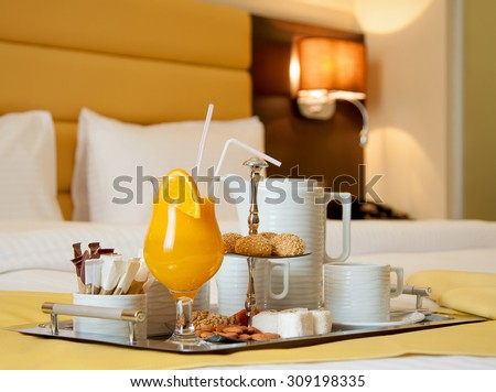 Breakfast in hotel, cup of coffee and  nut - stock photo