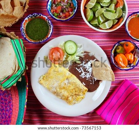 breakfast in mexico omelet eggs with chili sauce Mexican food - stock photo