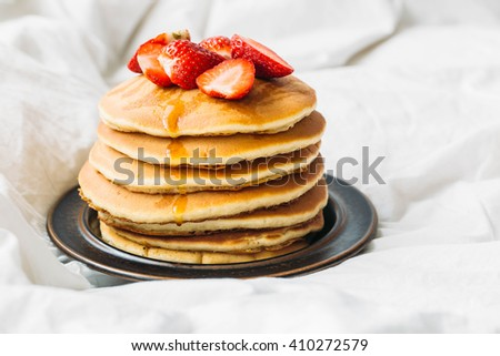 breakfast in the bad with pancakes and strawberry