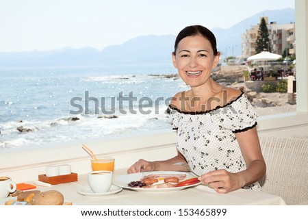 Breakfast in the seaside cafe - stock photo