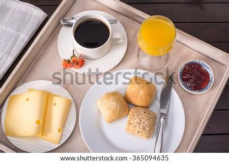 Breakfast including coffee, bread, orange juice - stock photo