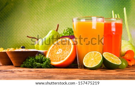 Breakfast including coffee, carrot,orange juice, muesli and fruits  - stock photo