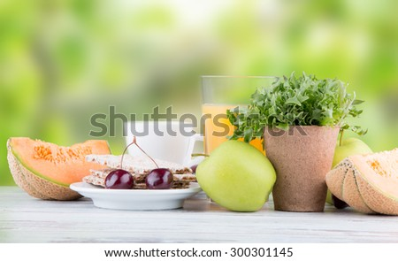Breakfast including coffee, orange juice, muesli, salad and fruits  - stock photo