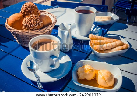 Breakfast is served outside in sunshine in Istanbul, Turkey. - stock photo