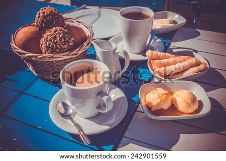 Breakfast is served outside in sunshine in Istanbul, Turkey. Toned image - stock photo