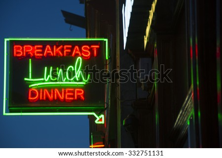 Breakfast Lunch Dinner Neon Sign at a New Restaurant - stock photo