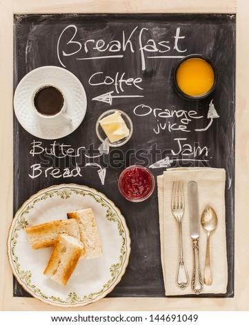 Breakfast menu on a blackboard - stock photo