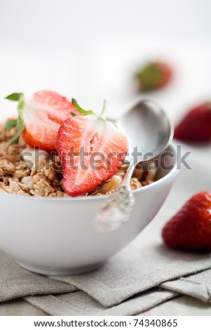 Breakfast muesli with fresh and sliced strawberries