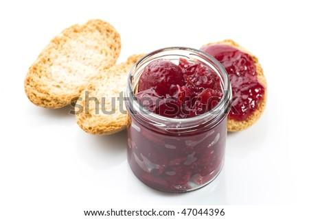 Breakfast of cherry jam on toast - stock photo