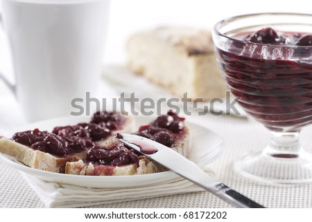 Breakfast of cherry jam on toast