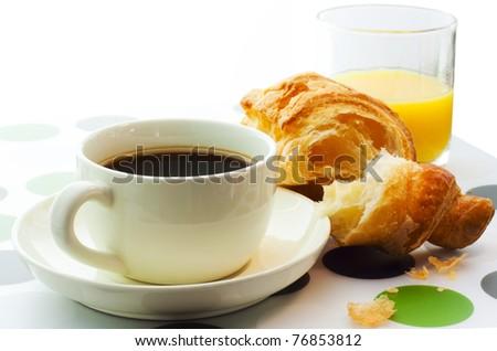 breakfast of coffee, orange juice and croissant - stock photo