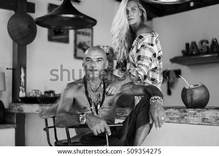 breakfast of young beautiful couple on nature. man and woman is hugging. Young Couple Eating Breakfast In Kitchen Together