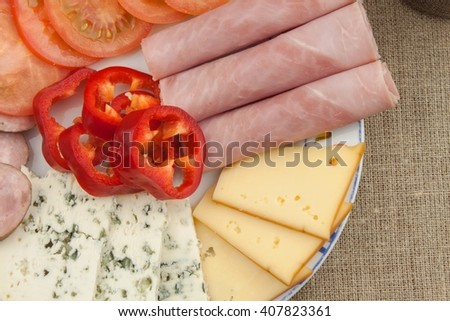 Breakfast on the table. Ham, tomato and cheese for breakfast with bread. Homemade healthy food. Vegetables and ham for breakfast. - stock photo