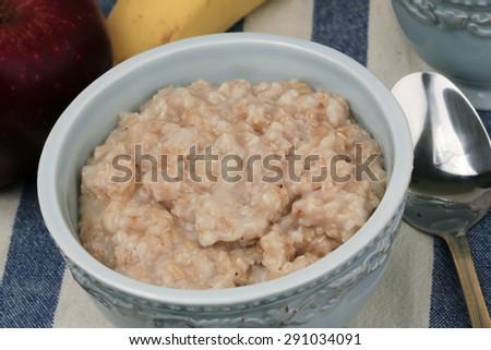 breakfast porridge in a ceramic bowl vintage - stock photo