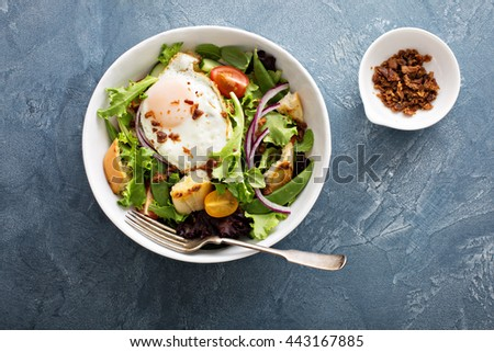Breakfast salad with toasted bread, eggs and bacon - stock photo