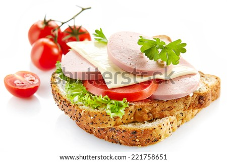 breakfast sandwich with sliced sausage and tomato isolated on a white background - stock photo