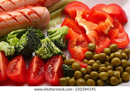 Breakfast sausages vegetables green peas - stock photo